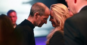 Steve Jobs touching foreheads with his wife